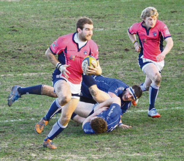 Dudley News: Centre Ben Barkley leaves a trail of Macclesfield tacklers in his wake en route to scoring his try.