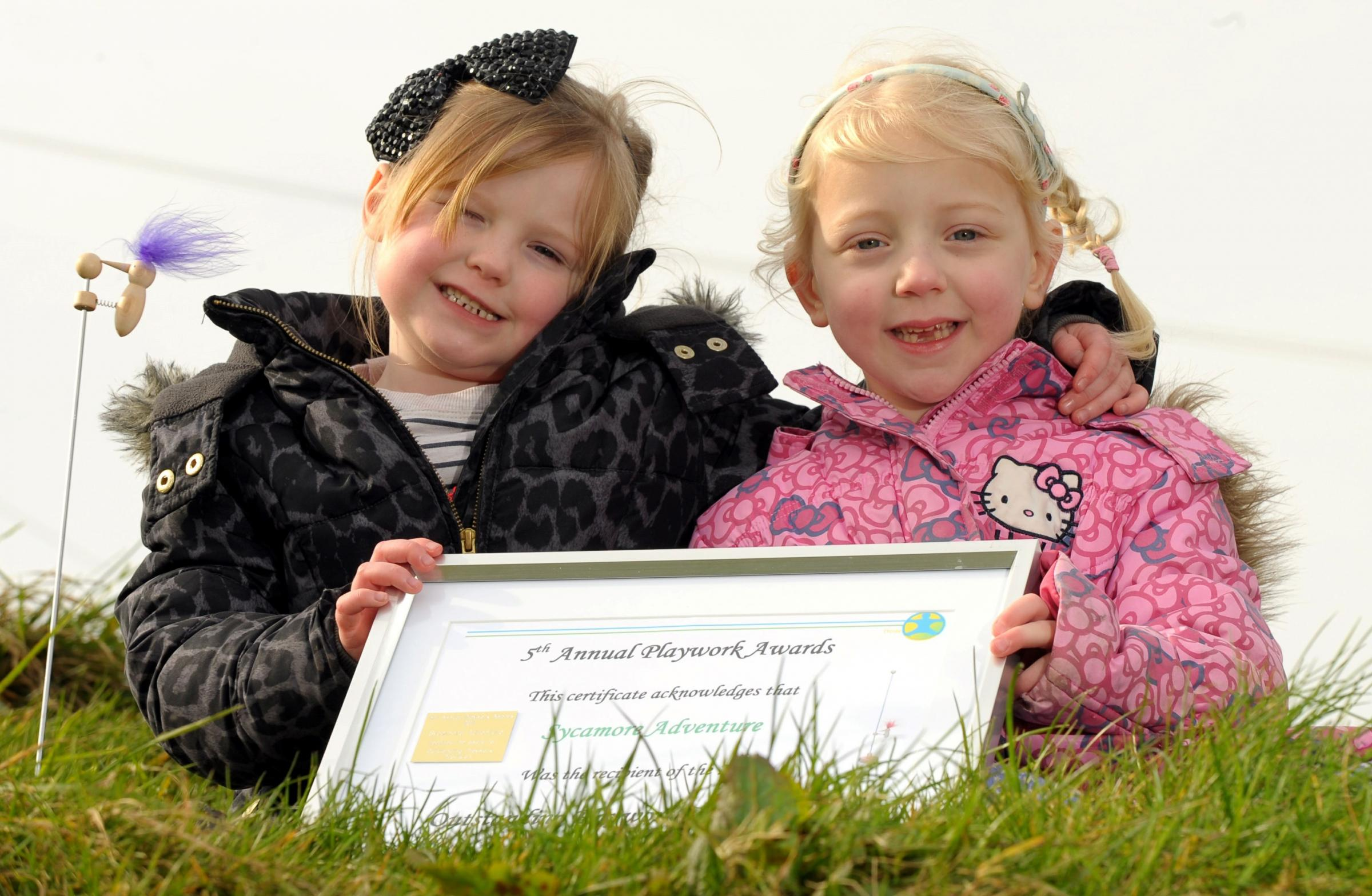 Millie-Jayne Jones, aged 5, left, and Abigail Neal, aged 5, right, celebrating the latest award for the Sycamore Adventure play centre 111422RS