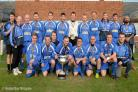 The Netherton Athletic team proudly display their trophy.