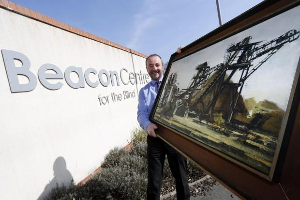 Arwyn Jones, chief executive of the Beacon Centre for the Blind, with the Edna Lumb picture.