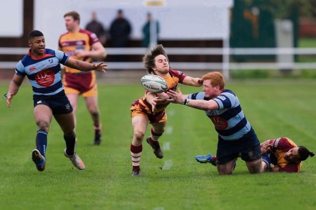 Dudley News: Harry Bayliss offloads to Donavan Smile during DK's loss to Sedgley Park. Photo: Ian Jackson