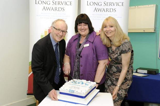 Dudley News: Chairman John Edwards, left, and chief executive Paula Clark, right, with Nicola Bussey (centre) who has dedicated 40 years to the Trust.