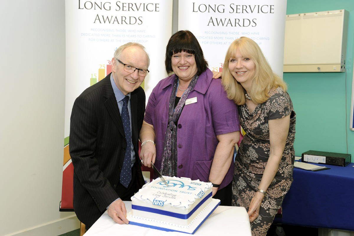 Chairman John Edwards, left, and chief executive Paula Clark, right, with Nicola Bussey (centre) who has dedicated 40 years to the Trust.
