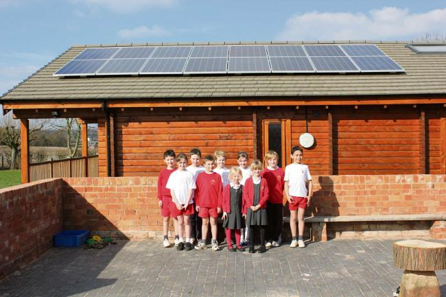 Children from Ombersley First Endowed School with their new solar panels. SP