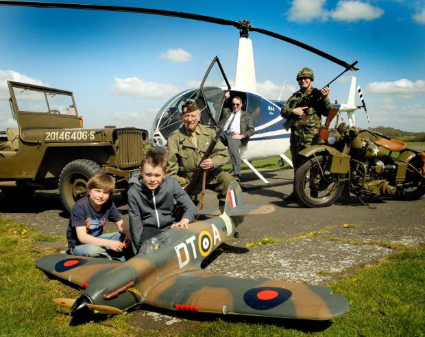 Josh Richards (10) and Henry Burton (9) with a model Hurricane fighter, John Vaughan, Roy Targonski and Richard Currinn. Buy this photo: 161426L.