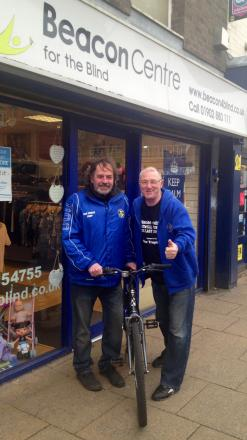 Fundraisers Graham Hodson and Mel Perry at Beacon's charity shop in Bilston High St.