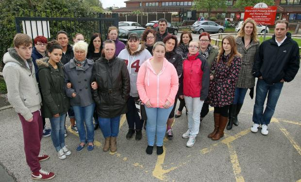 Angry parents at Hurst Hill Primary School are calling for the head and chair of governors to quit