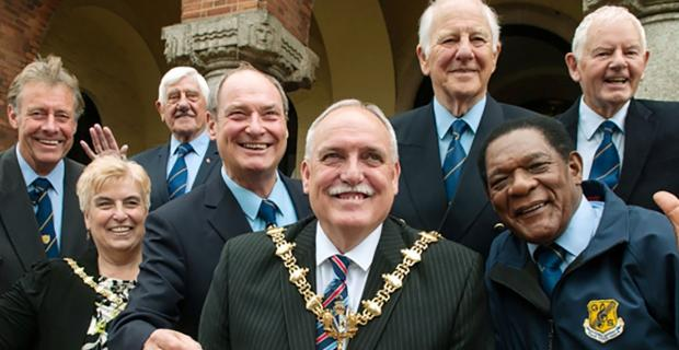 Dudley News: Outgoing Dudley mayor Cllr Alan Finch and mayoress Heather Finch with The Gentlemen Songsters at the civic reception where the choir handed over a donation of £3,500.