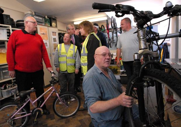 Visitors at City Can Cycle's recent open day saw volunteers working on bikes for donation to needy families
