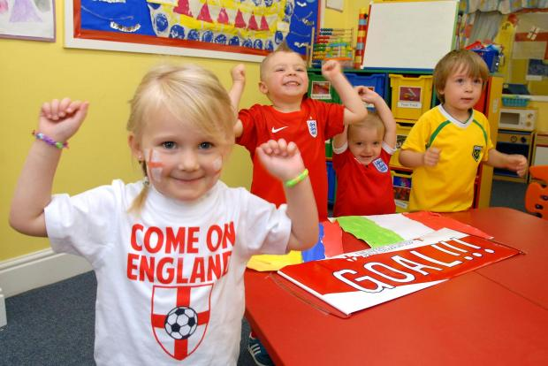 Dudley News: Early Years nursery World Cup party l-r Charlotte Smith (4), Ryan Freeman (4), Alivia Hancox-Parkes (2) and Dylan Smith (4). Buy this photo: 251404M.