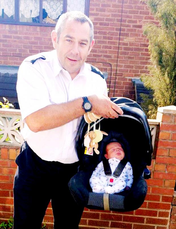 Dudley News: Watch commander Russ Gauden and baby Joseph. Picture by West Midlands Fire Service