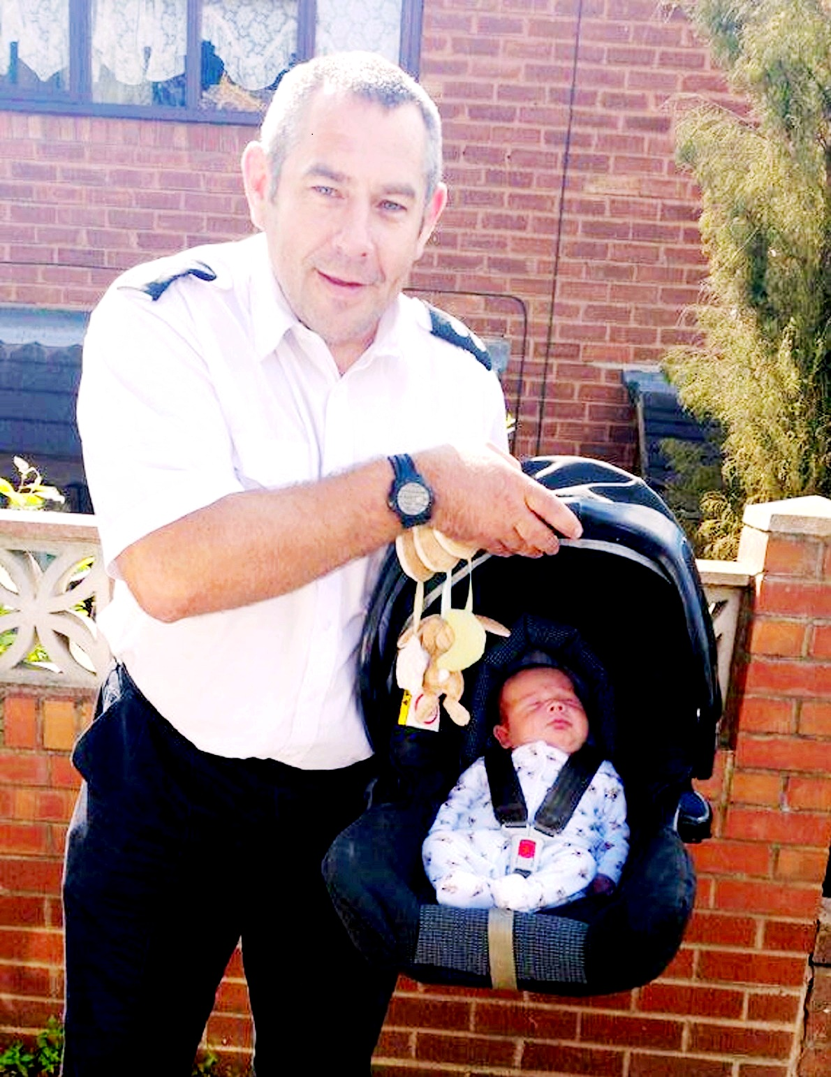 Watch commander Russ Gauden and baby Joseph. Picture by West Midlands Fire Service