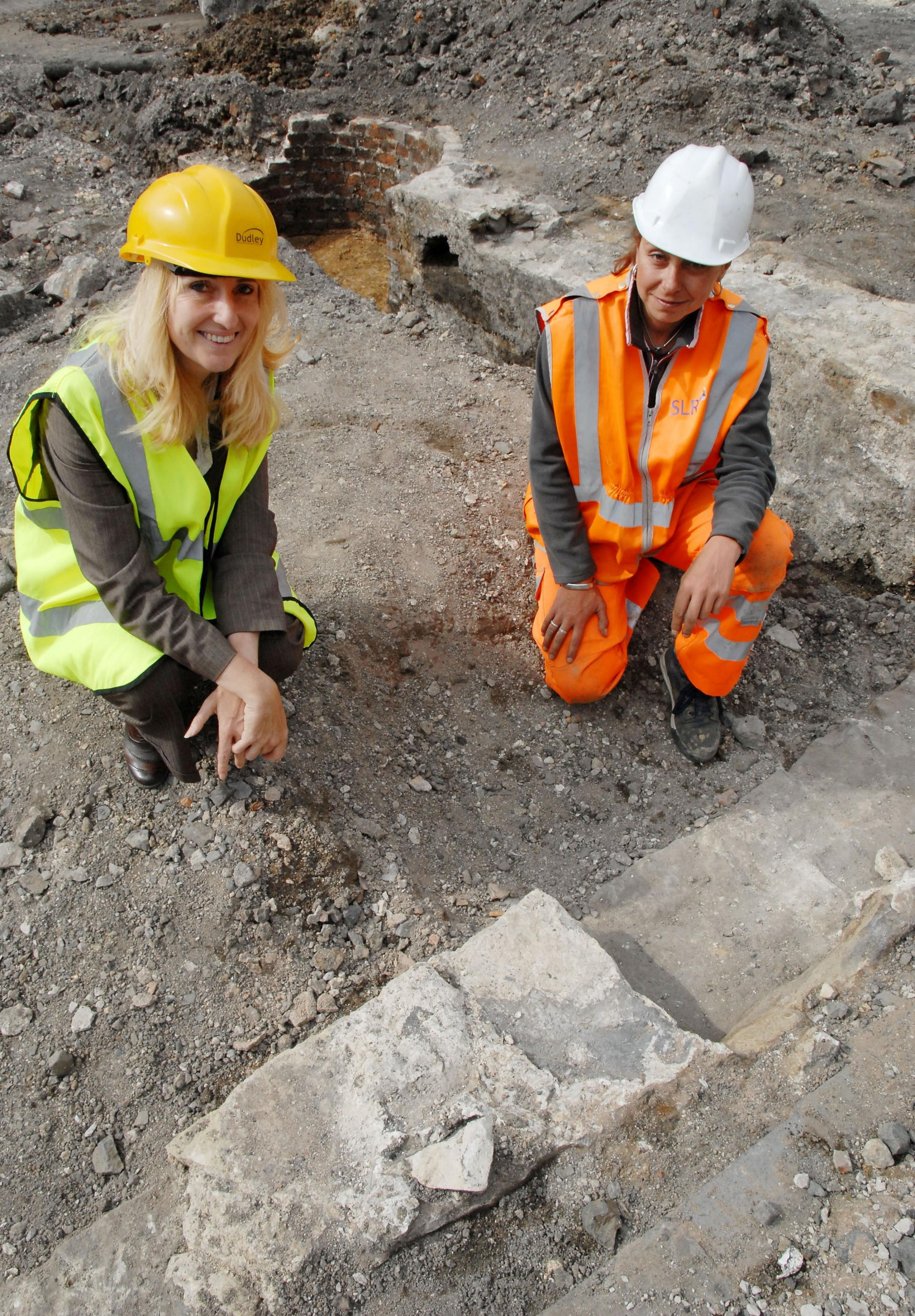 l-r Cllr Judy Foster with Kate Griffiths, SLR consulting archaeologist, at the site Dudley town centre market place. 261481M
