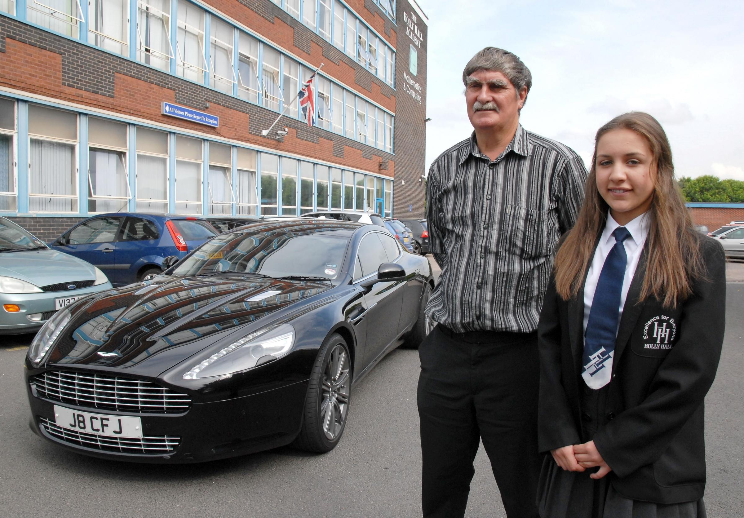Colin Jones and Alisha Jarrett with the Aston Martin at Holly Hall Academy