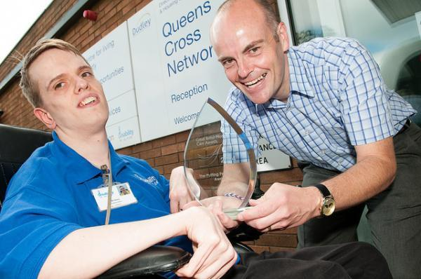 Jodie Simner, from Disability in Action, celebrates the award with Paul Astley, unit manager at Queens Cross Nework