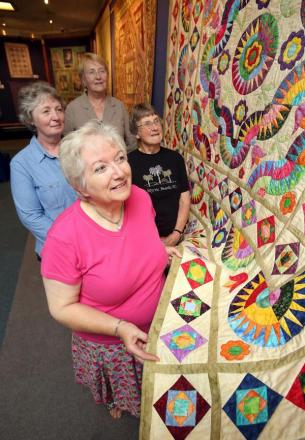 Quilt exhibition at Dudley Museum: back l-r Jane Mallard, Cllr Hilary Bills and Maureen Hart with Mary Lowe. Buy this photo: 291410J.