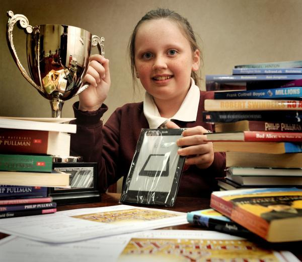 Overall winner Shannon Jackson with her writing competition trophy and prize.