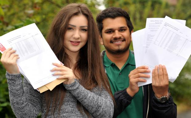 Bishop Milner students Helen Hobbs,  aged 17,  (two A's, B and C), and Kishan Patel, aged 18,  (three A* and two As). 341409L
