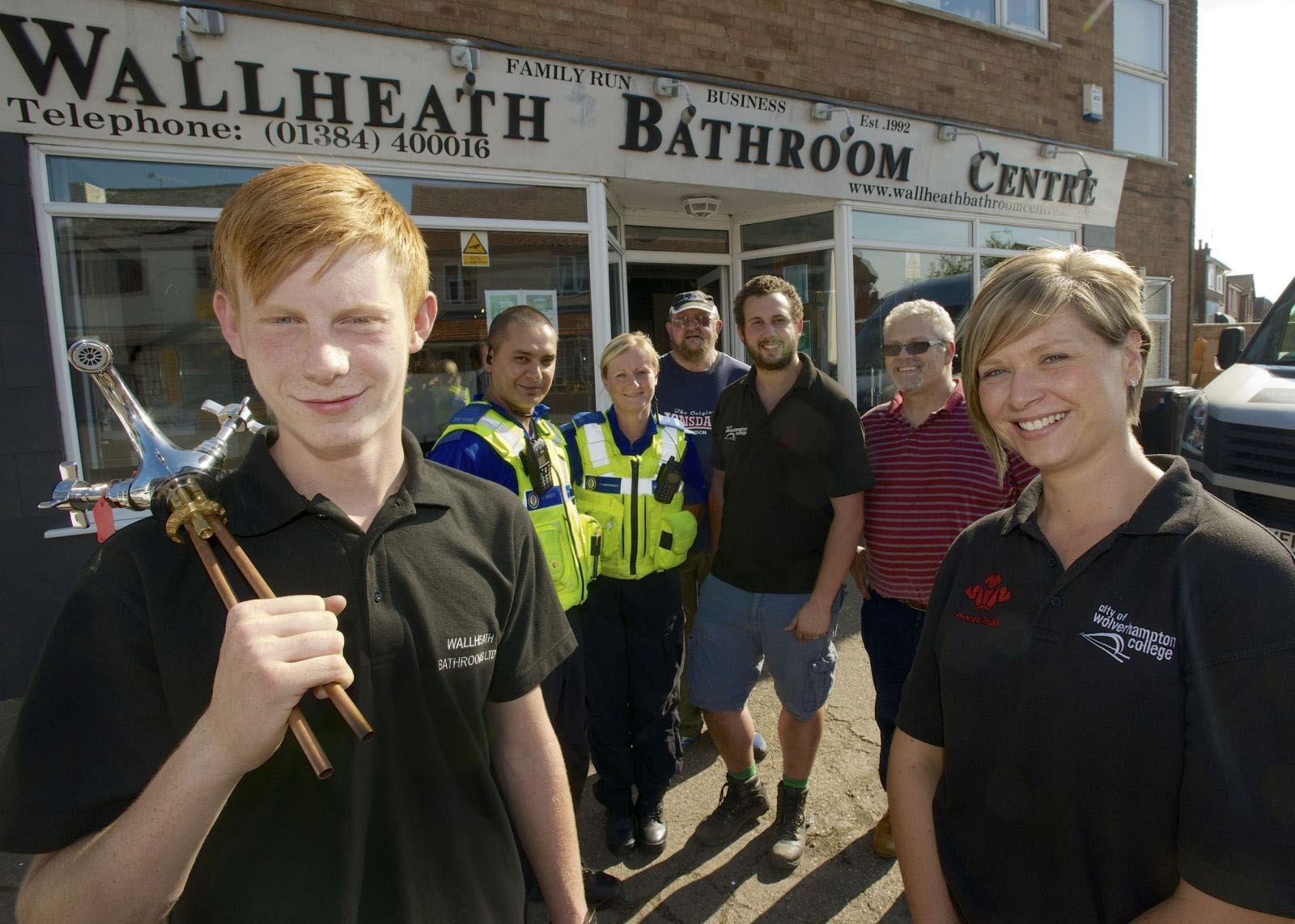 Foreground: Shaun Abbott and PCSO Hayley Giles.Background: L/R PCSO Omar Shairiff, PCSO Faye Cartwright, Frank Price  from City Can Cycle, Tom Taylor (City of Wolverhampton College, Assistant Team Leader), Stephen Taylor (Owner of Wall Heath Bathroom Cent