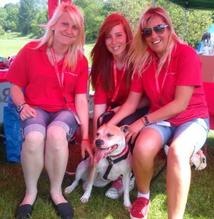 L-r Becky Riese, co- founder of Ravens Rescue, volunteer Lauren Hinton, aged 16, and Sarah Harris, co-founder, with Caro the rescue dog.