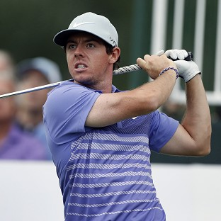 McIlroy shares lead in Denver