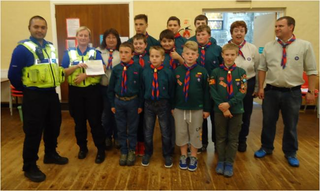 Castle and Priory PCSO's Omar Sharif and Faye Cartwright handing their donation of £1,500 to members of the 1st Upper Gornal Scout Group.