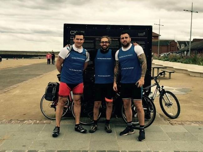 Andrew Baxter, Rikki Theodosi and Scott Moore at the end of their coast-to-coast cycling challenge in aid of Mary Stevens Hospice
