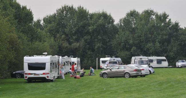 Travellers pictured on playing fields near Sainsbury's Amblecote