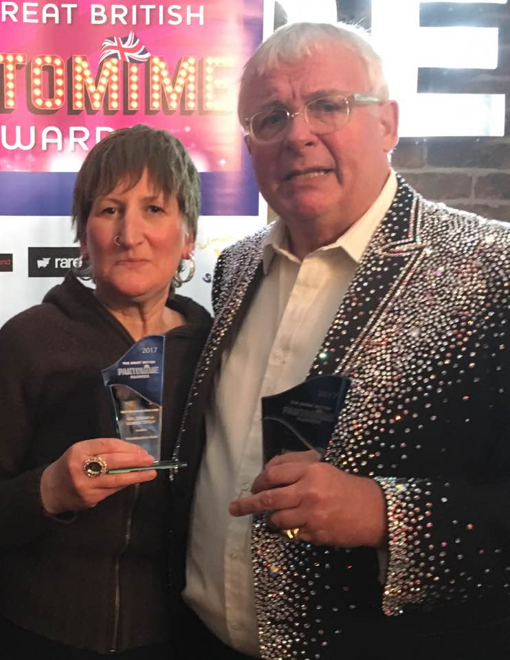 Doreen Tipton receives her award from Christopher Biggins