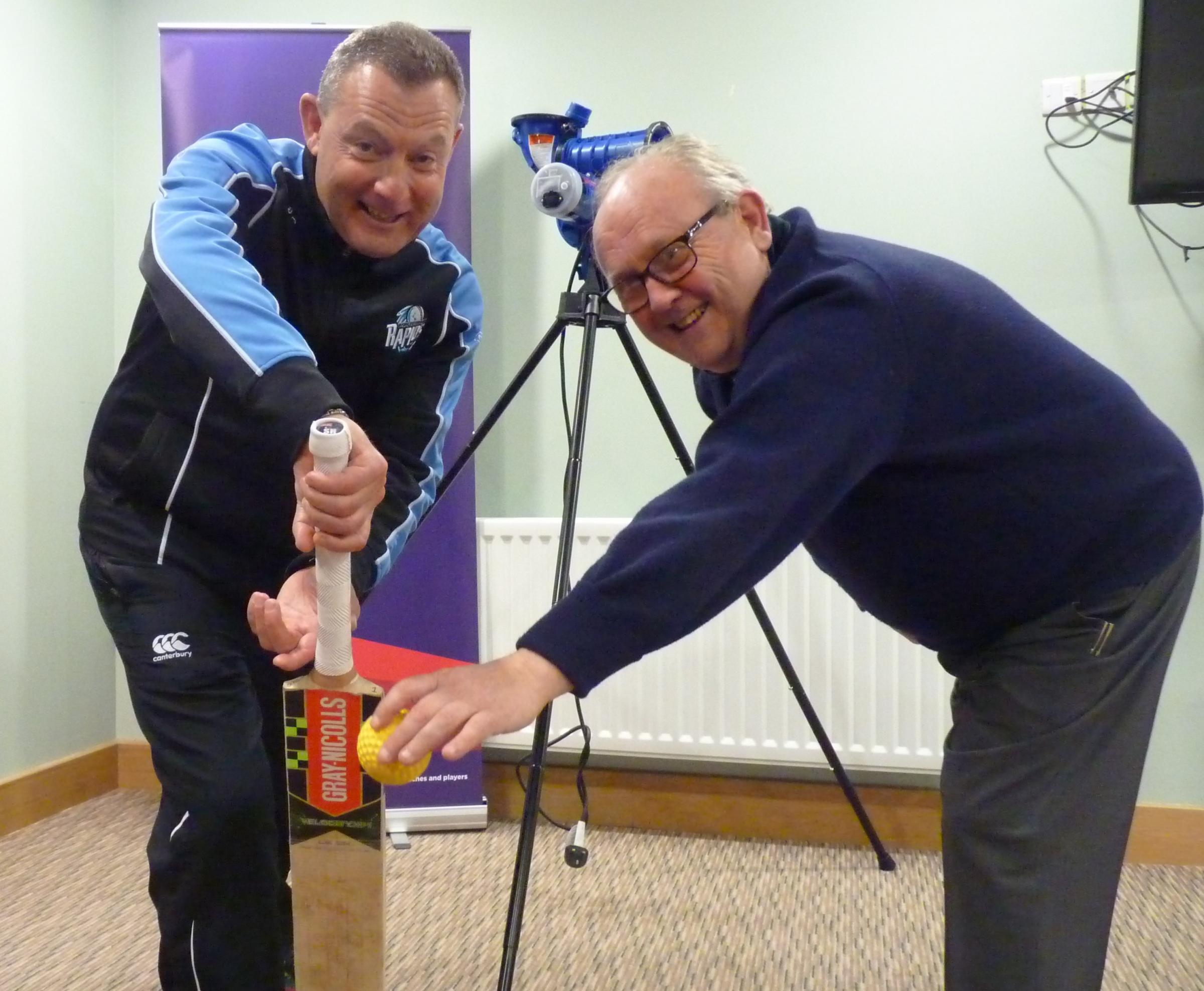 Worcestershire CC head coach Kevin Sharp and Enville CC cricket development officer Paul Grainger with Enville's new bowling machine.