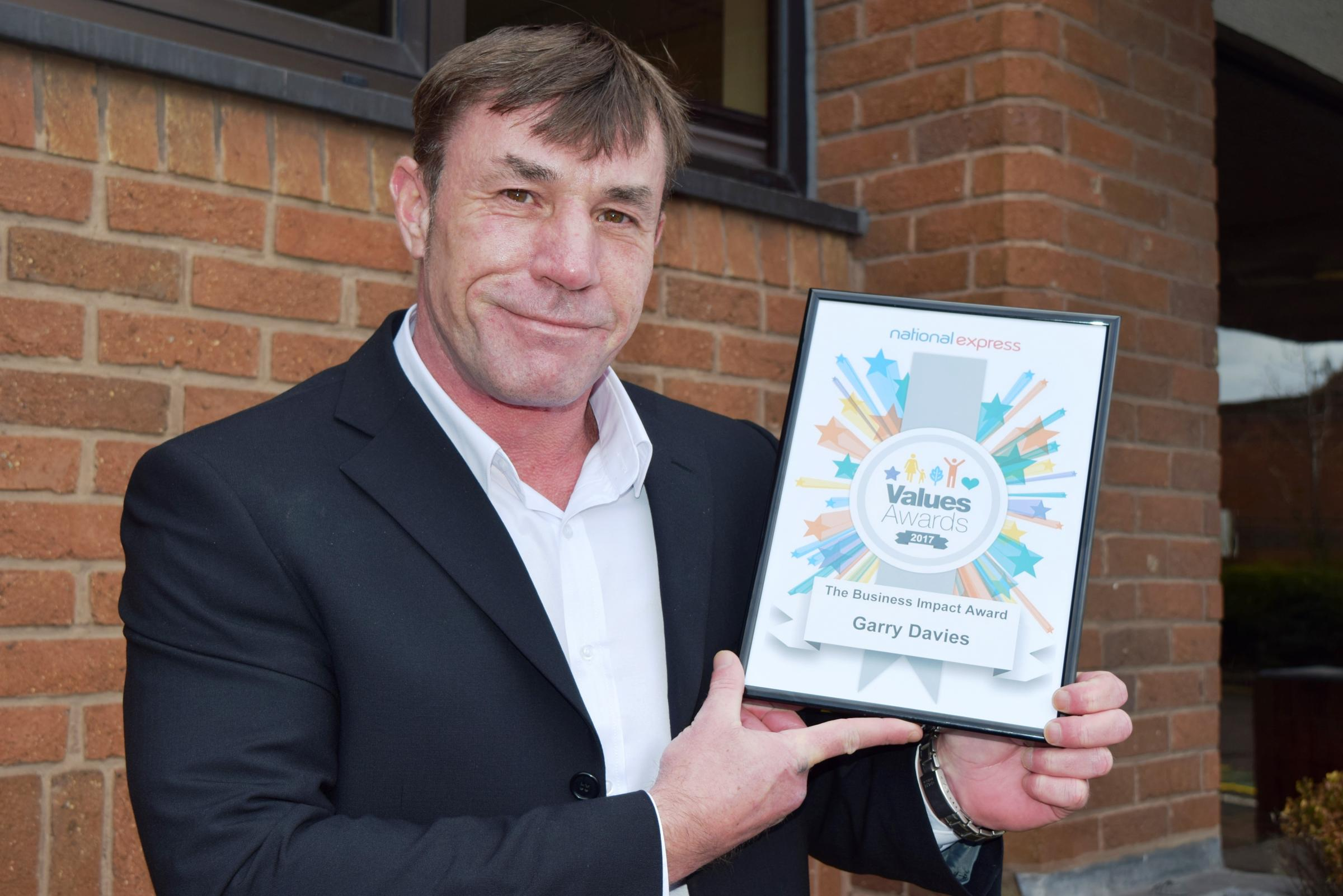 Garry Davies with his award