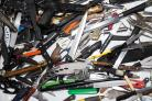 A display of weapons by West Midlands Police, which are among weapons emptied from the region's knife surrender bins.