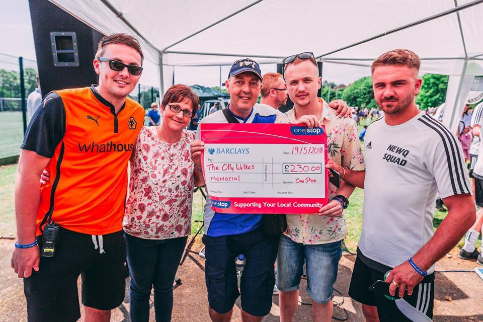 Left to right: Olly's brother Ben, mother Lynn and father Simon with Luke Gorton from One Stop and Olly's friend Joel Fullwood with one of the many donations made on the day. Pictures by Ben Jancso.