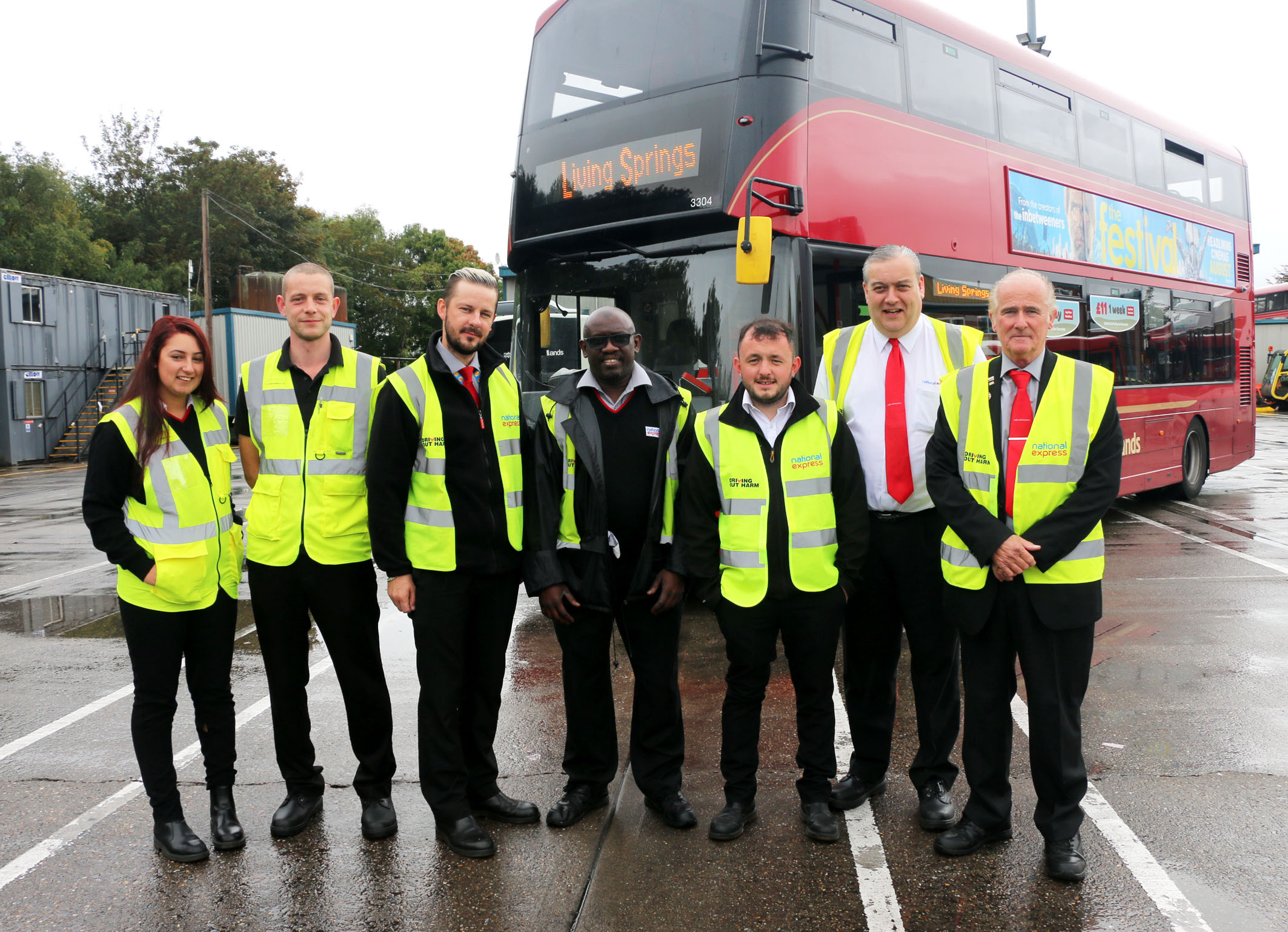 Dave Gerard, far right, with bus drivers and office staff