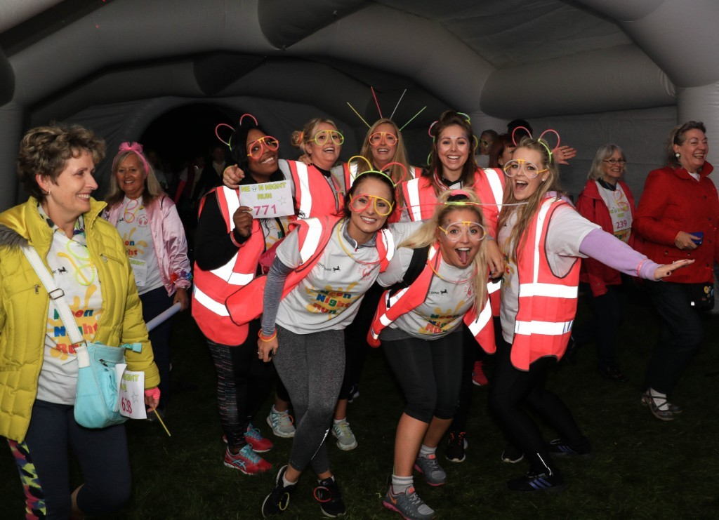 Hospice supporters enjoying the dance tunnel at the Neon Night Run