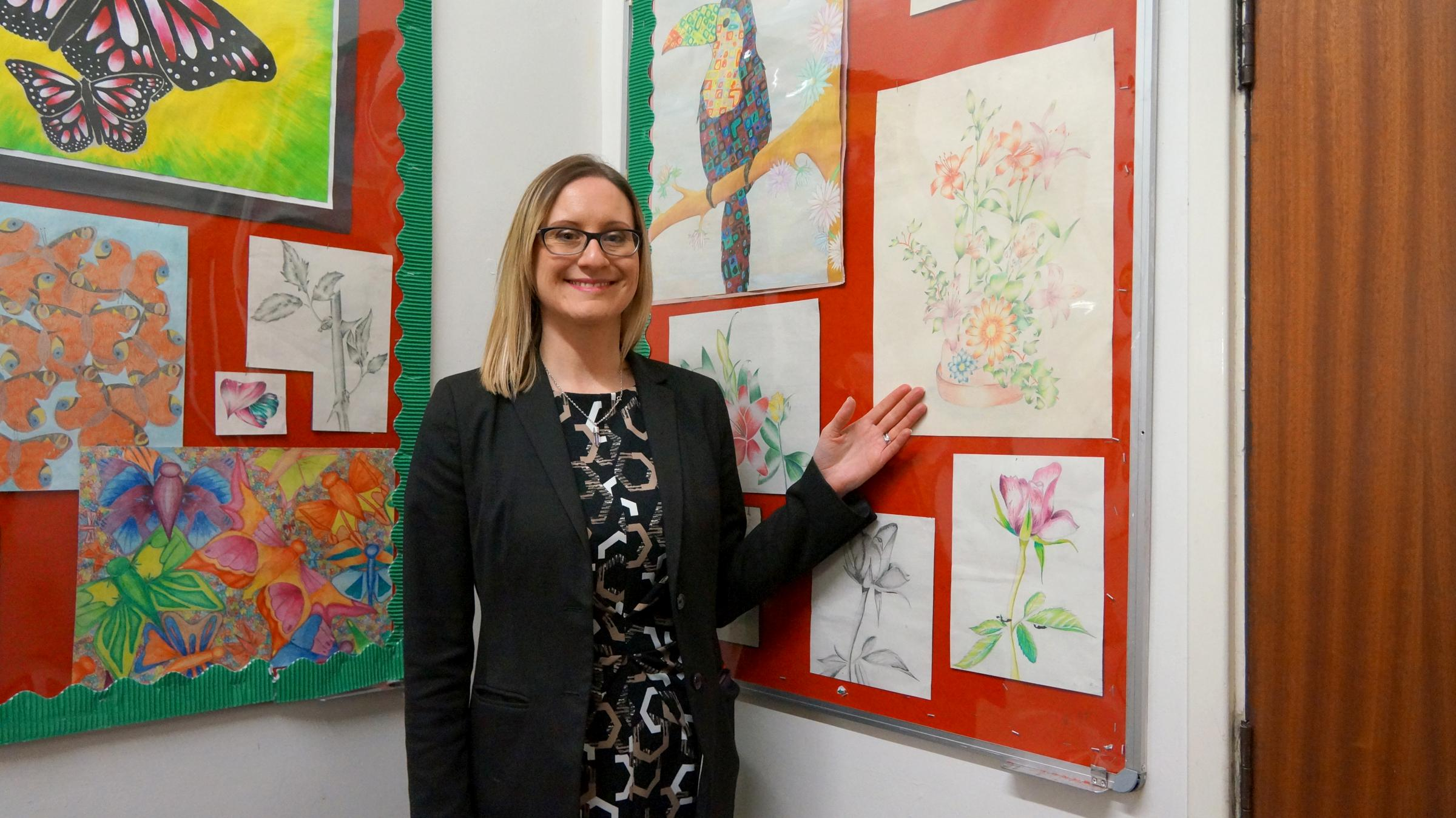 Emma Edwards-Morgan, Principal of The Link Academy, with artwork on display she made as a pupil at the school.