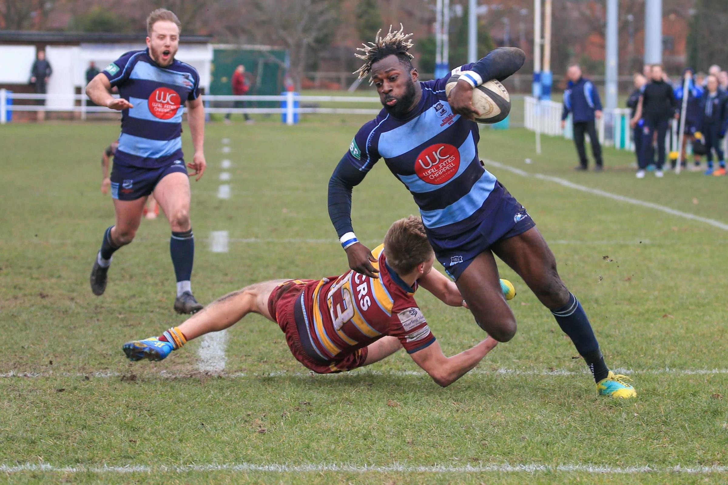 Charles Buffour rounds his man to score his third try. Photo by Ian Jackson
