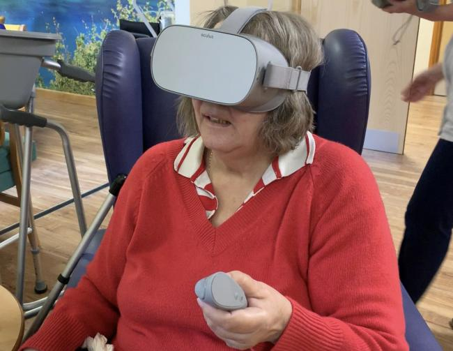 Daphne Barnes enjoys the new virtual reality headsets at Rowley Regis Hospital's Heart of Sandwell Day Hospice.