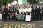 Pupils past and present protested outside the school as the summer term ended.