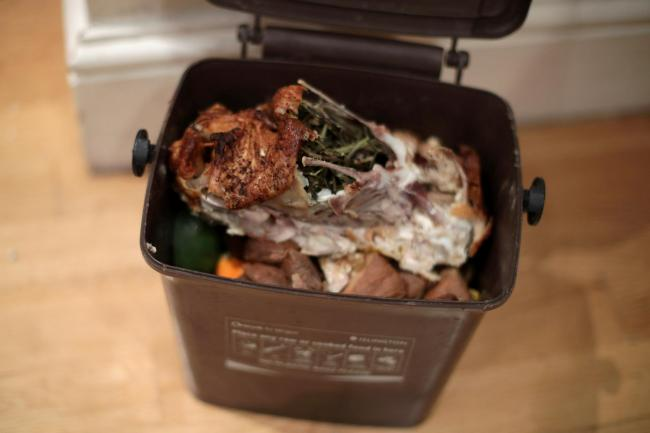 Food waste in a food recycling bin, as an estimated 10.2 million tonnes of food and drink are wasted every year in the UK after leaving the farm gate